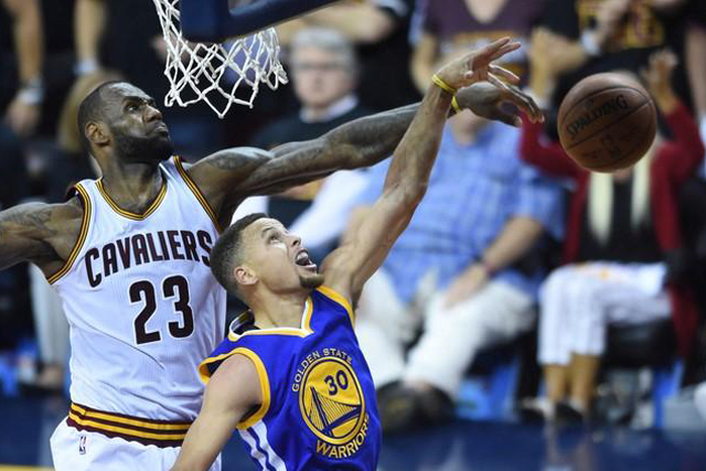 Friday, June 17, 2016 Cleveland Cavaliers forward LeBron James (23) blocks the shot by Golden State Warriors guard Stephen Curry (30) during the fourth quarter in game six of the NBA Finals at Quicken Loans Arena. Mandatory Credit: Ken Blaze-USA TODAY Sports