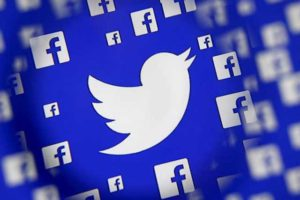 Logo of the Twitter and Facebook are seen through magnifier on display in this illustration taken in Sarajevo, Bosnia and Herzegovina, December 16, 2015.