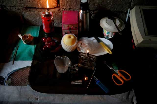Monday, June 20, 2016 Sachets of shabu, or methamphetamine (middle-lower part), is pictured among other drugs paraphernalia at an undisclosed drug den in Manila, Philippines June 20, 2016. REUTERS/Staff