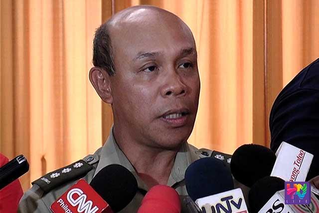 Col. Noel Detoyato speaks to reporters.