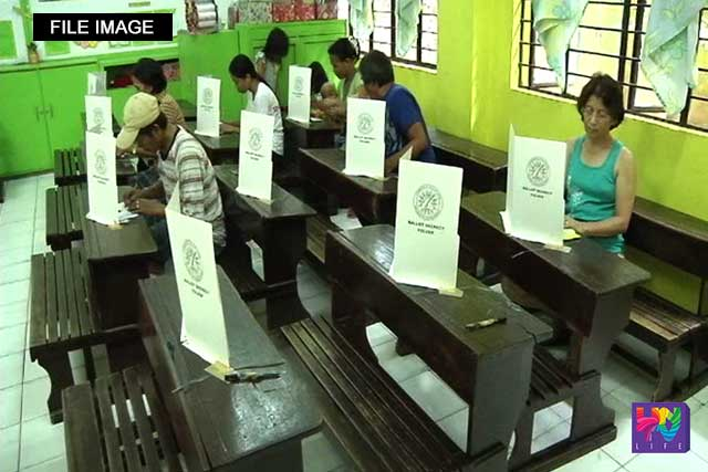 Voters cast their votes in a polling precint in this file photo.