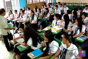 A teachers speaks in front of students of Barangka National High School in Marikina City.