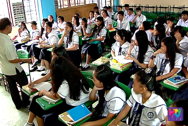 A teachers speaks in front of students of Barangka National High School in Marikina City.