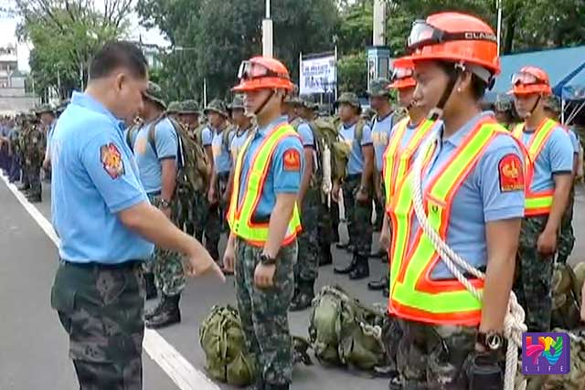 Directorate for Police Community Relations Executive Officer P/CSupt. Carlos De Sagun inspects equipment and PNP personnel alike in the NHQ - DIMTG Disaster Preparedness Audit 2016.
