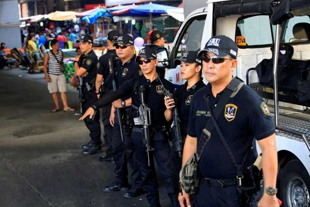 Tuesday, June 28, 2016 Members of the Philippine National Police Special Reaction Unit gather as part of a police visibility operation along a main road in Metro Manila, Philippines, June 4, 2016. REUTERS/Romeo Ranoco/File Photo