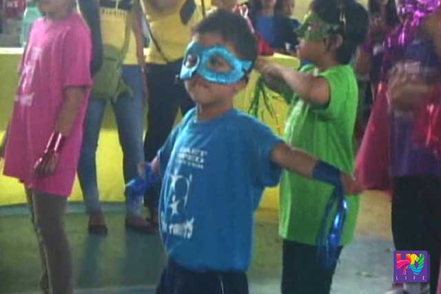 File photo: a child with autism wears a mask as he dances.