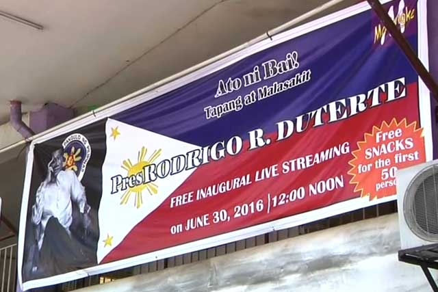 A tarpaulin is displayed along the street of Davao City informing the public of live streaming of incoming President Rodrigo Duterte.