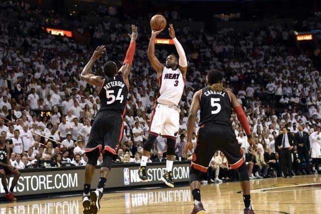 May 9, 2016; Miami, FL, USA; Miami Heat guard Dwyane Wade (3) shoots over Toronto Raptors forward Patrick Patterson (54) during the fourth quarter in game four of the second round of the NBA Playoffs at American Airlines Arena. The Heat won in overtime 94-87. Mandatory...