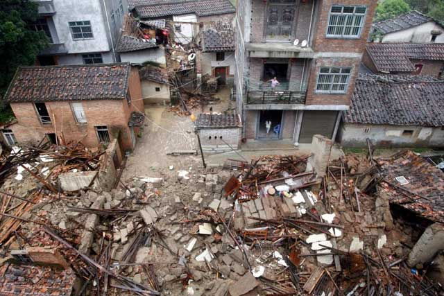 Monday, July 11, 2016 Damaged and collapsed buildings are seen as Typhoon Nepartak brings heavy rainfall in Putian, Fujian Province, China, July 9, 2016. Picture taken July 9, 2016. REUTERS/Stringer
