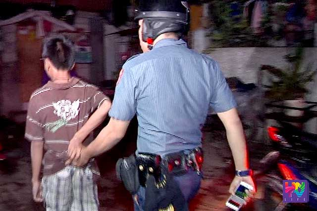 A police personnel apprehended a minor who violated curfew.