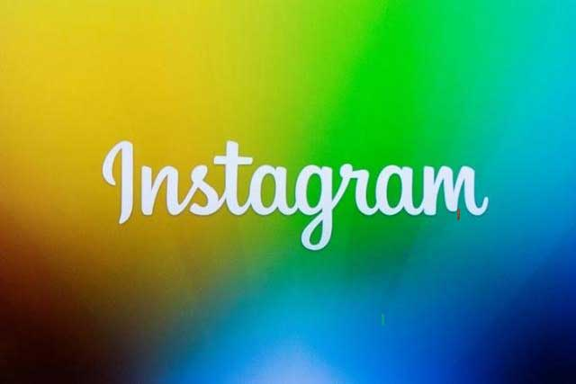A screen displays the Instagram logo during a presentation in New York December 12, 2013. REUTERS/LUCAS JACKSON/FILE PHOTO - RTSGU5I