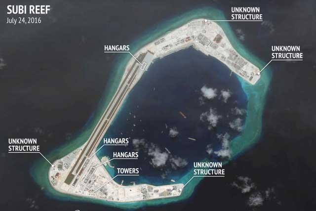 Tuesday, August 09, 2016 Construction are seen on Subi Reef in the Spratly islands, in the disputed South China Sea in this July 24, 2016 satellite image released by the Asian Maritime Transparency Initiative at Center for Strategic and International Studies (CSIS) to Reuters on August 9, 2016. CSIS Asia Maritime Transparency Initiative/DigitalGlobe/Handout via REUTERS