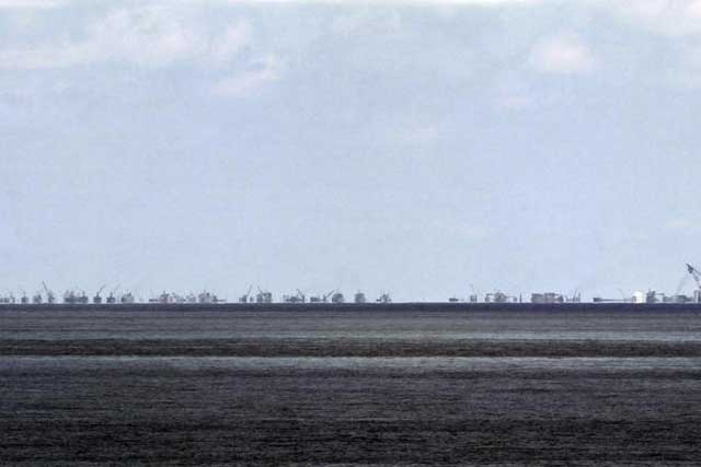 The alleged on-going land reclamation of China at Subi reef is seen from Pagasa island (Thitu Island) in the Spratlys group of islands in the South China Sea, west of Palawan, Philippines, May 11, 2015. REUTERS/Ritchie B. Tongo/Pool
