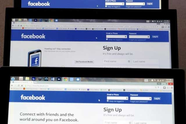Computer screens display the Facebook sign-in screen in this photo illustration taken in Golden, Colorado, United States July 28, 2015. REUTERS/Rick Wilking/File Photo