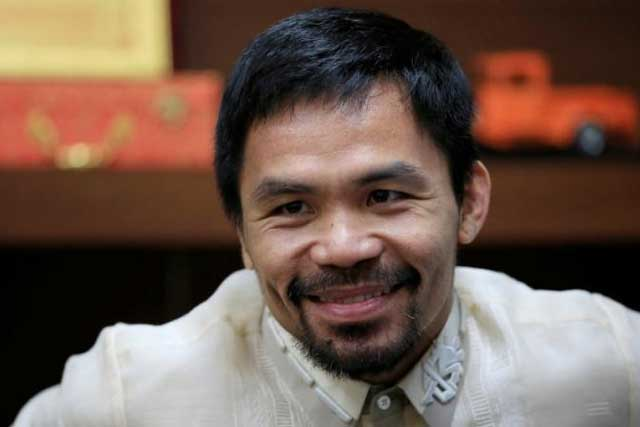 Senator and boxing champion Manny 'Pacman' Pacquiao smiles during a Reuters interview inside his office at the Senate headquarters in Pasay city, metro Manila, Philippines September 28, 2016. REUTERS/Romeo Ranoco