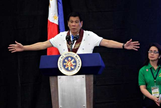 President Rodrigo Duterte speaks during a meeting with banana production businessmen in Davao city, in southern Philippines, October 7, 2016. REUTERS/Lean Daval Jr/File Photo