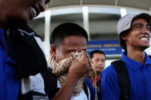 Some of the 26 Asian sailors released after being held captives by Somalia pirates for more than four years become emotional as they arrive at the Jomo Kenyatta International airport in the capital Nairobi, Kenya, October 23, 2016. REUTERS/Siegfried Modola