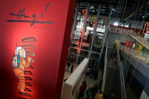 A giant poster of Tintin is seen inside the Centre Pompidou modern art museum in Paris December 19, 2006. REUTERS/Benoit Tessier/File Photo