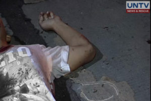 A lifeless body sprawling on the ground is seen in a file photo.