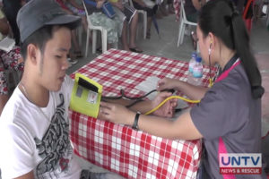 A resident getting his blood pressure checked during the medical and dental mission from UNTV and Members Church of God International in Brgy. Ampid 1, San Mateo, Rizal.