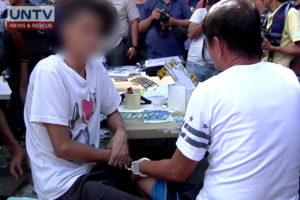 The 2 suspects arrested by QCPD for selling and producing fake licenses, and car plates