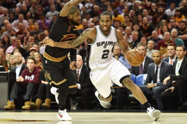 Jan 21, 2017; Cleveland, OH, USA; San Antonio Spurs forward Kawhi Leonard (2) drives to the basket against Cleveland Cavaliers guard Kyrie Irving (2) during the second half at Quicken Loans Arena. Mandatory Credit: Ken Blaze-USA TODAY Sports