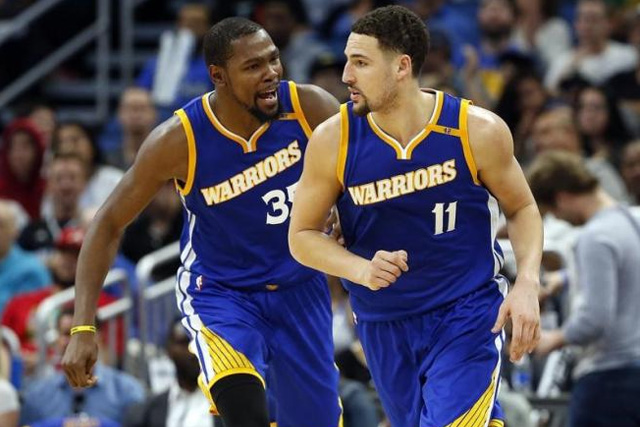 Jan 22, 2017; Orlando, FL, USA; Golden State Warriors forward Kevin Durant (35) congratulates guard Klay Thompson (11) during the second half at Amway Center. Golden State Warriors defeated the Orlando Magic 118-98. Mandatory Credit: Kim Klement-USA TODAY Sports
