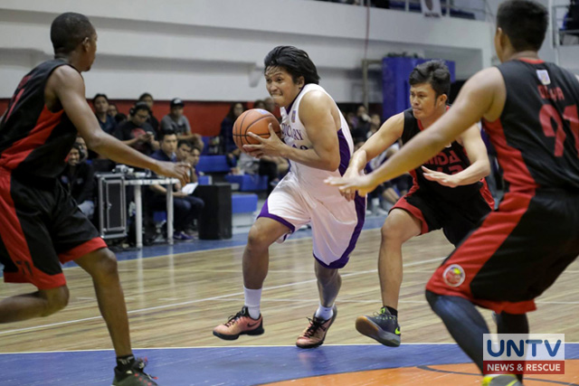Judiciary Magis' Chester Tolomia going hard in breaching the defense of the MMDA Black Wolves during their match on January 22, 2016 at the Pasig City Sports Center for the UNTV Cup semifinals slot qualifier.  (Rey Vercide  / Photoville International)
