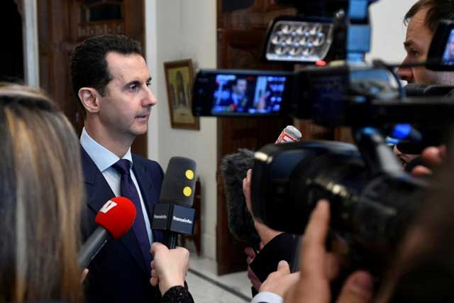 Syria's President Bashar al-Assad speaks to French journalists in Damascus, Syria, in this handout picture provided by SANA on January 9, 2017. SANA/Handout via REUTERS Syria's President Bashar al-Assad speaks to French journalists in Damascus, Syria, in this handout picture provided by SANA on January 9, 2017. SANA/Handout via REUTERS