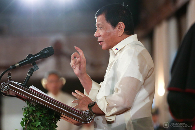 FILE PHOTO: President Rodrigo Roa Duterte encourages the envoys from different countries across the globe to work hand in hand to address the global issues in his message during the New Year Vin d'Honneur at the Rizal Hall in Malacañan Palace on January 11, 2017. The Vin d' Honneur gathers envoys from different countries across the globe for a toast with the Philippine President. TOTO LOZANO/Presidential Photo