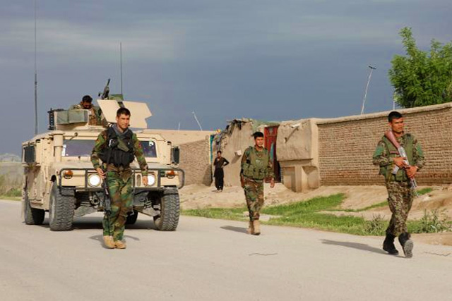 100 dead and wounded after attackers in uniform storm Afghan base