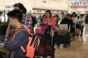 FILE PHOTO: Passengers at NAIA