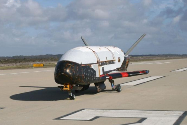 US space plane on secret mission lands back on Earth