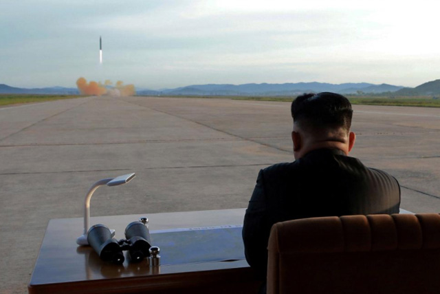 North Korean leader Kim Jong Un watches the launch of a Hwasong-12 missile September 16. KCNA via REUTERS