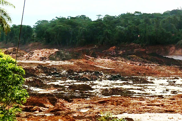 Sludgy aftermath of the collapsed dam in  Brumadinho, Brazil  that has left  nearly 100 dead and hundreds still missing.  | Image grabbed from a Reuters video
