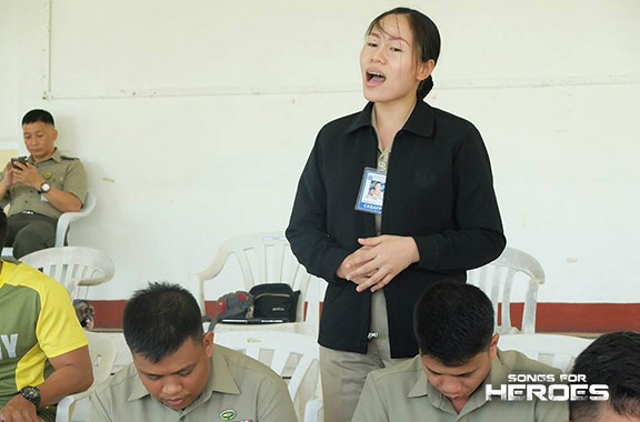 A member of the AFP chorale shows off her singing talent during one of the Songs for Heroes 2 rehearsals.