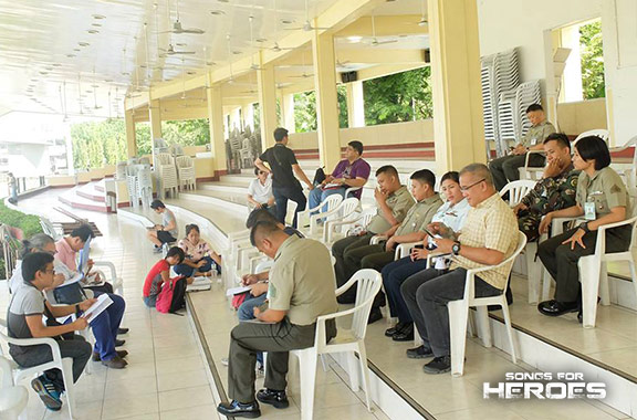The organizers of Songs for Heroes 2 and the performers from the AFP gather at the AFP Grandstand in Camp Aguinaldo for a briefing about the concert.