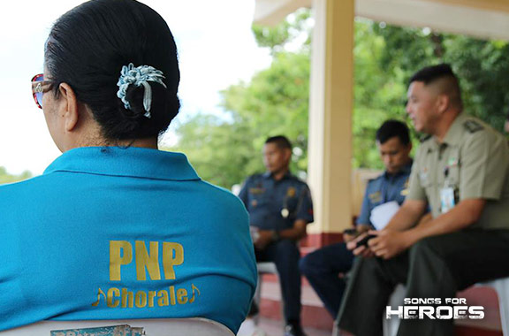 A member of the PNP Chorale listens during a meeting between the Songs for Heroes 2 participants from the PNP and AFP.