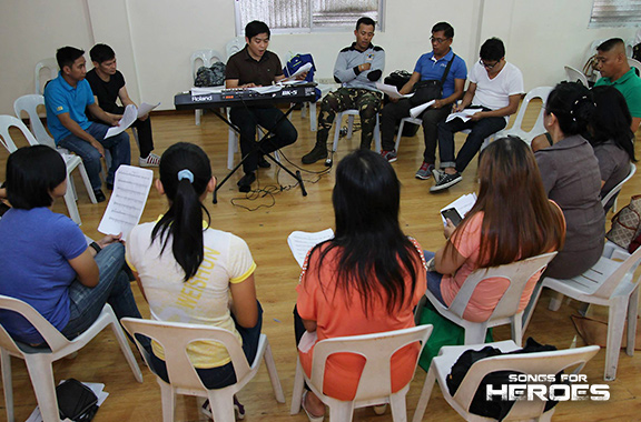 Members of the AFP and PNP Chorale rehearse for the upcoming Songs for Heroes 2.