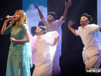 "Theater actress Jenine Desiderio takes the concert stage along with the BMPI dancers for the performance of Lea Salonga's ""Lipad."""