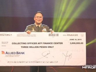 Gen. Catapang receives the check worth Php 4 million, half of the proceeds raised by Songs for Heroes 2.