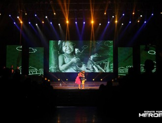 Arnee Hidalgo and Sam Shoaf share a sweet moment at the Songs for Heroes 2 concert stage as they share a duet for the first time before a huge crowd.
