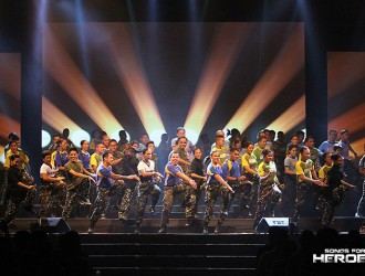 Dancing for fellow defenders. Selected members of the AFP and PNP join forces for a production number during the benefit concert, Songs for Heroes 2.