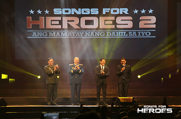 A rare moment. AFP Chief of Staff Gen. Gregorio Catapang, PNP OIC Gen. Leonardo Espina, PBC President Atom Henares and BMPI Chairman and CEO Daniel Razon share the stage of Songs For Heroes 2 to pay tribute to the country's defenders.